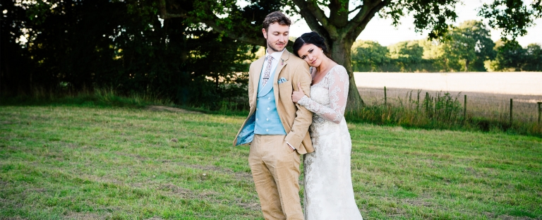 Sussex wedding photographer Sharron Goodyear photographs newlyweds in a park